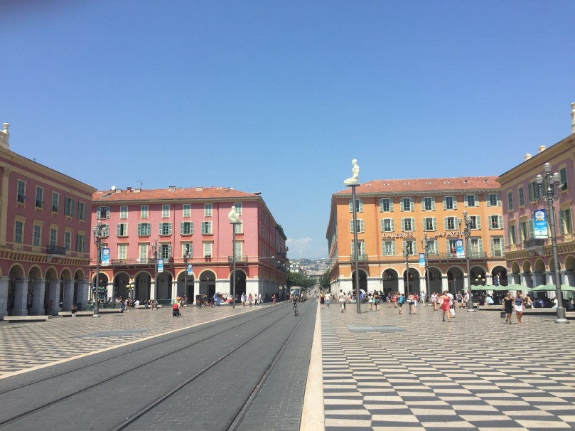 Place Massena. Photo taken about a week ago. We were by one of the pillars in a crowd, when people started running from the promenade, spilling into the square.